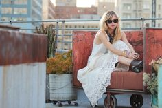 can this be my life?  lounging on a rooftop garden in a big city, wearing a long flowy white dress.