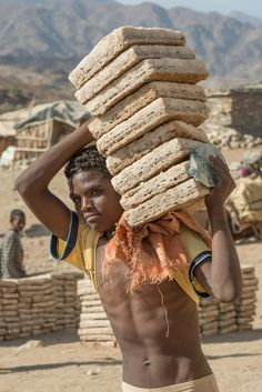 Danakil Salt ~ At an altitude of 1,000m, the small town of Berahile is a mid-way stop for salt caravaneers between the Danakil Depression and Mekelle. Some unload their cargo and transfer it onto trucks; others continue the journey uphill on foot.