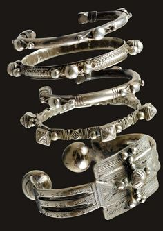 Mauritania | Four bracelets and an anklet from Mauritania | Silver | 20th century