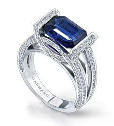 Now this is what a call a ring! 3.67 emerald cut sapphire and  diamond halo ring. Stunning! Xoxox