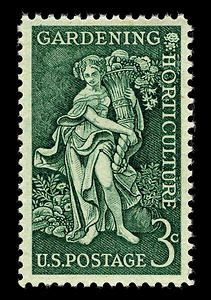 This 1958 stamp honors gardeners and horticulturists. The figure in the center represents a bountiful earth, holding a horn of plenty and surrounded by flowers, fruits, vegetables and shrubs.