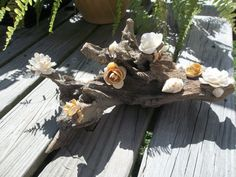 Reserved for Anita:  Shell Flower and Driftwood Centerpiece for Wedding. $60.00, via Etsy.