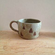 Floating Triangles Ceramic Mug, low and wide pale green coffee cup with triangle design, wheel thrown speckled coffee mug