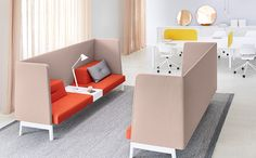Ophelis Docks high back two seat sofa with integrated power access in pink and red, white legs and frame. Workplace touch down design