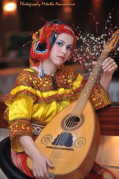 Africa |  Young Berber woman playing the Mandole.  Algeria |  ©  Metatla Noureddine