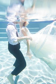 """Cassie Leah Photography thought it'd be fun to literally """"take the plunge"""" with this couple who love the beach, water, and are even planning on getting hitched on a floating chapel!"""