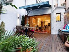 Indoor-outdoor outdoor living design with deck & sculpture using timber - Outdoor Living Photo 332260