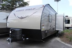 2016 New Forest River Grey Wolf 26RL Travel Trailer in Florida FL.Recreational Vehicle, rv, 2016 Forest River Grey Wolf26RL, 15k A/C IPO 13.5k Std, Aluminum Rims, Black tank flush, Core Package, Dinette Cabinet Door(1), Drop In Cooktop with Glass Cover , Enclosed Tanks, External LED Strip Lighting, Faux Rock at Entertainment Center , Flip Down Travel Rack, High Gloss Seamless Countertop, Internal Accent LED Strip Lighting , Outside TV Bracket and Hook Ups , Power Awning, Power Tongue Jack…