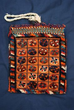 "Antique Spindle-Bag, Qashqa'i Tribes, South-West Persia  This beautiful old Spindle-Bag is in excellent condition bar a small bite out of the bottom of the bag, as can be seen in the close-up image. Dating to around 1900, the colours are all natural - the orange colour derived from mordanted madder. Although mainly flatwoven, the bag consists of a knotted-pile border and charming tufts of woollen pile in the compartmentalised field.  Size: 41cm x 33cm (1' 4"" x 1' 1"")."