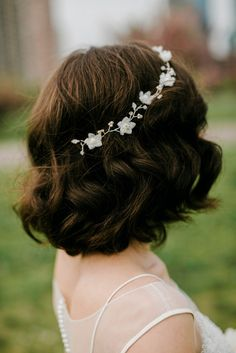 Short, Curly Bridal Hairstyle with Headband | Bumble & Bumble | Lev Kuperman Photography https://www.theknot.com/marketplace/lev-kuperman-photography-brooklyn-ny-520014