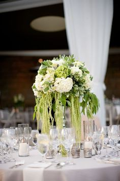 Like the tall silver, as well as the assortment of low candles. - however do not like the hanging greens anymore.