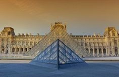 Pyramid at Louvre-Paris - The Louvre Pyramid was built in the 1980s as the main entrance to the Louvre Museum. The modern glass structure, which forms a nice contrast with the historic facades of the Louvre, has become a landmark in its own right.I took this picture about 6 pm in the evening,the sun is going down but the real sunset is around 9 pm.I had to wait because I wanted to take night scene at this place.Thanks for coming,have a great day friends.....