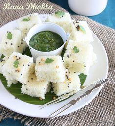 Rava Dhokla, the steamed savory cake made from semolina. Though i have prepared khaman dhokla regularly as our snack for tea time, this r. Indian Snacks, Indian Food Recipes, Vegetarian Recipes, Ethnic Recipes, Appetizer Recipes, Snack Recipes, Cooking Recipes, Appetizers, Veg Recipes