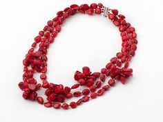Multi strand red coral necklace: http://www.aypearl.com/wholesale-coral-jewelry/wholesale-jewellery-X1110.html