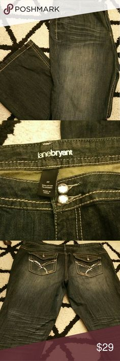 Lane Bryant Embellished Boot cut Jeans size 22 Dark denim Boot cut Jeans with very little stretch. Fit more like a size 18/20 very long will need to be hemmed if under 5'5. Have minor holes at hem from being too long and puckering in hip area. Excellent condition otherwise. Lane Bryant Jeans Boot Cut