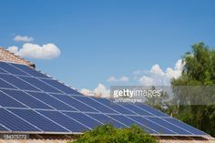 Stock Photo : Sky and Solar Panels on Tile Roof