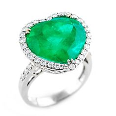 Heart Shaped Columbian Emerald Ring One of a kind and extremely rare! Gorgeous vivid green Columbian Emerald, weighing in at 13.32 carats, set in 18 karat white gold. Round brilliant diamonds are set in a halo and accenting the band, weighing .70ct.
