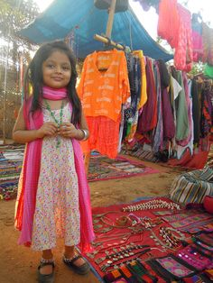 India, Goa flea market and precious little girl