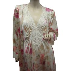 Vintage Olga in a rare color pattern of roses, nightgown and peignoir robe set. Vintage Olga set is stunning with those roses scattered throughout the gown and the robe. Rarely does one come across this color pattern in an Olga. Absolutely a br...