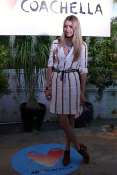 Gigi Hadid worked her lightweight striped H&M dress with the perfect marriage of turquoise accessories: a choker statement necklace and tie-front belt.                  Source: POPSUGAR Photography / Grace Hitchcock