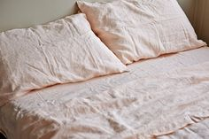 IN BED peach linen sheets and pillowslips