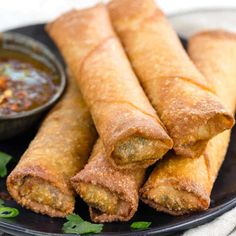 Egg rolls are often store-bought or ordered at Chinese restaurants, but making this crispy appetizer at home is easy! These vegetarian finger foods are filled with mushrooms, carrots, cabbage, and bean sprouts. #video #eggrolls #chinesefood #appetizer