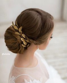 Low chignon bun hairstyle with hair vine - This elegant wrapped chignon is the perfect second-day hairstyle idea! .chignon wedding hairstyles