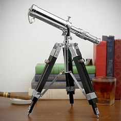 Reach for the stars with our tabletop telescope. This beautiful brass telescope makes for dignified office, study, or den accessory with its adjustable height wooden legs, detailed fully functional...