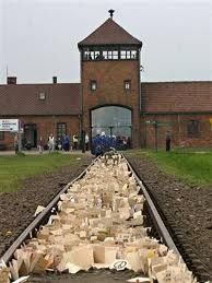 Auschwitz II-Birkenau. The main gate to the camp. The wooden plaques, usually with names of the victims, were left by the participants of the March of the Living.