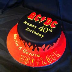 Heavy metal ACDC band cake for a fan's 40th. For tickets to all your favourite bands - www.tikbuzz.co.uk