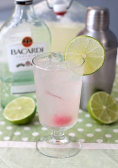 Lime Daiquiris (1/2 cup fresh lime juice 1/2 cup water 1/4 cup granulated sugar 6 ounces light rum 4 marashino cherries lime wedges)