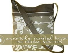 Cross-Body Pocketed Hipster PDF TUTORIAL & PATTERN (Instant Download):  This is by far one of my favorite bags! The Pocketed Hipster is the perfect size; everything is so convenient. With two roomy pockets on the exterior and a keyring to quickly clip your keys, what more could you want?  The Cross-Body Pocketed Hipster can be worn cross-body or with a shoulder strap. The front exterior features one open pocket and one zipper pocket. A key clip for your convenience is located on the back ...