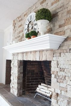DIY fireplace and mantel makeover. Click over to see how I transformed my brick fireplace to stone and made the mantel by repurposing an old piece of furniture.