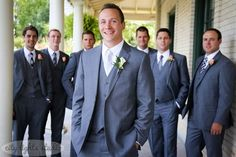 The groom and his groomsmen in a grey color