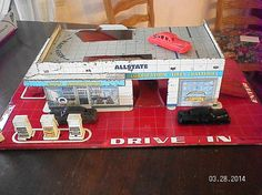 VINTAGE SEARS - ALLSTATE SERVICE STATION METAL TOY...WITH 4 CARS AND GAS PUMPS
