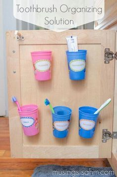 Toothbrush Organizing Solution-Links to the blog. She used velcro to attach the cups to the door.