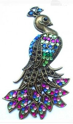 Bronze Peacock decorated with colored stones. I just love this!