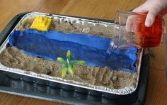 Start with an aluminum 9X13 pan and make a river bed out of the aluminum foil to fit down the middle of the pan.    Using modeling clay, no...