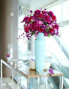 beautiful purple flowers in baby blue vase