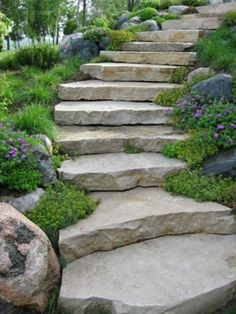 Want to use stone slabs? I'll be honest, I love stone steps. But no lie… you need a professional for this job. And a tractor. :) From 'Robinson Landscaping'…