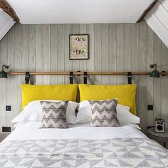 Grey & white bedroom with wood panelling in Small Space Design Ideas. Small white & grey attic bedroom with wood panelling, DIY headboard and yellow accents. Source by kellyrmount The post Small room ideas appeared first on Whitney DIY Design. Attic Bedroom Designs, Attic Bedroom Small, Headboard Designs, White Bedroom, Small Rooms, Small Spaces, Headboard Ideas, Attic Bathroom, Master Bedrooms