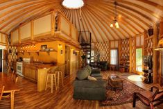 Yurt enthusiasts favor the design of these tent-like homes because of the large, open feeling of the interior space and the possibilities they offer in terms of decoration and social activities. This model from Blue Ridge Yurts is a good example of a yu Yurt Living, Tiny Living, Home And Living, Outdoor Living, Living Room, Yurt Interior, Interior Design, Yurt Home, Dome House