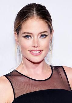 Doutzen Kroes' exaggerated cat-eye gives her eyes a lift, and the inner corner sparkle balances the thick black eyeliner beautifully.