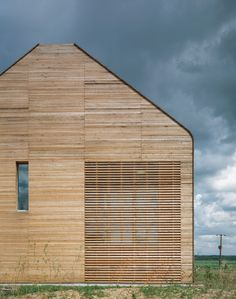 Welney Visitor Centre / by Allies & Morrison Architects / Improving visitor accessibility to the Wetlands, this new building provides a connection to the birdwatching hides and contains exhibition and education space, office accommodation and a meeting room, shop and cafe. Visible across the open fenland in which it sits, its barn-like form makes reference to neighbouring agricultural structures.