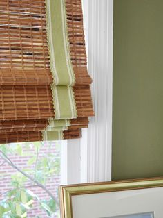 Rest assured: This easy DIY takes less than 20 minutes. Measure the shade's length when straight, and cut two pieces of trim accordingly. Starting 2 inches in from the edges, adhere trim with a hot-glue gun.