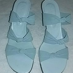 Donald J.Pliner Elastic strap heels,worn once. Comfortable fit,does not slide,made extremely well. Elastic straps need to be cleaned off a little...otherwise EUC Light powder blue is the color Donald J. Pliner Shoes Heels