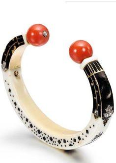 Tendance Bracelets AN ART DECO IVORY ENAMEL CORAL DIAMOND AND GOLD SUDANESE BANGLE CARTIER CIR