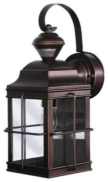 """Country - Cottage Motion Sensor 14 3/4"""" High Antique Bronze Outdoor Light  $89.99  This carriage-style outside wall lamp offers great looks plus the convenience of a built-in motion detector and dusk-to-dawn sensor. A handy security feature around garages and patios the motion sensor has a 150 degree 30 foot range."""