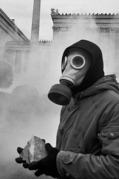 A gas mask clad demonstrator holds a large stone in Syntagma Square in the center of Athens, Greece on February 10, 2012. During a 48 hour general strike, demonstrators clashed with riot police in front of the Greek Parliament. UPI/Giorgos Moutafis