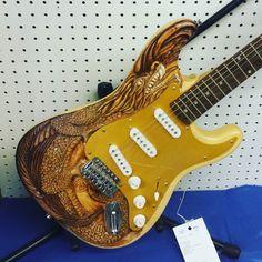 Woodcarving guitar. #woodcarving #eriecountyfair